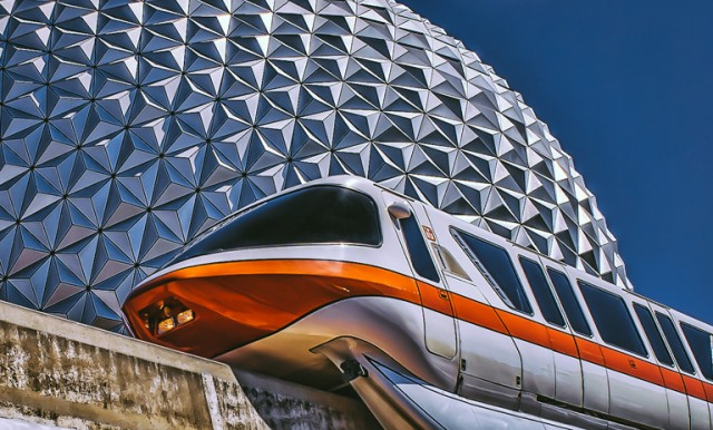 The monorail rounds Spaceship Earth on it's journey to Epcot! Photo by Judd Helms.