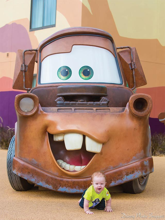A toddler with Mater at the Art of Animation Resort