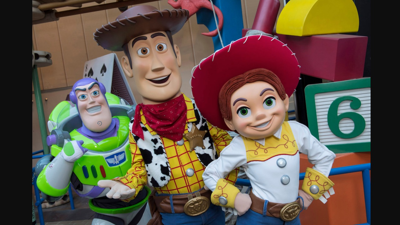 Buzz Lightyear, Woody and Jesse in front of Toy Story Mania