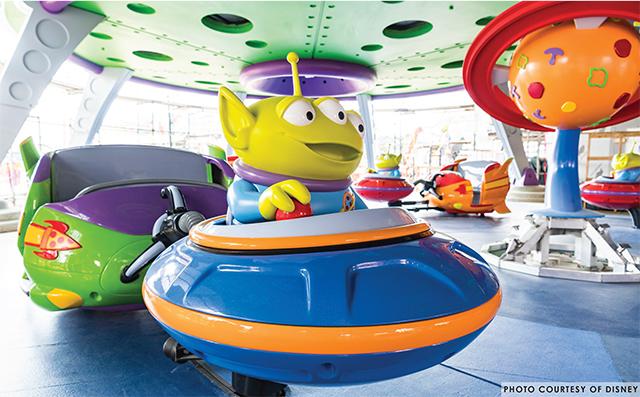 A green alien riding alien Saucer Swirl
