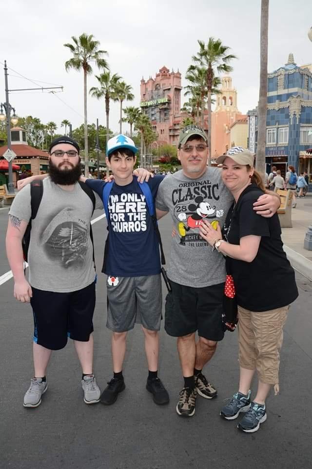 A family poses at Disney's Hollywood Studios at Walt Disney World Resort
