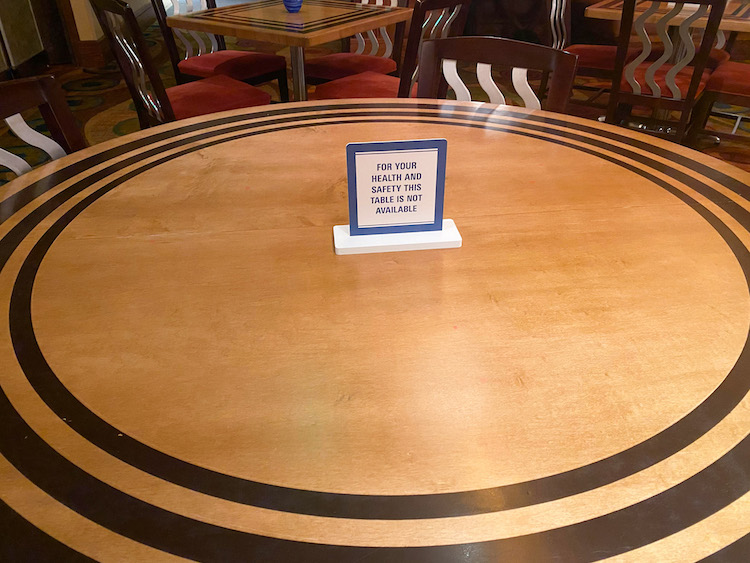 Table Signs blocking off tables dining procedures at Disney