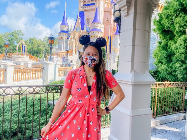 Disney World Reopened Wearing a Mask in front of castle