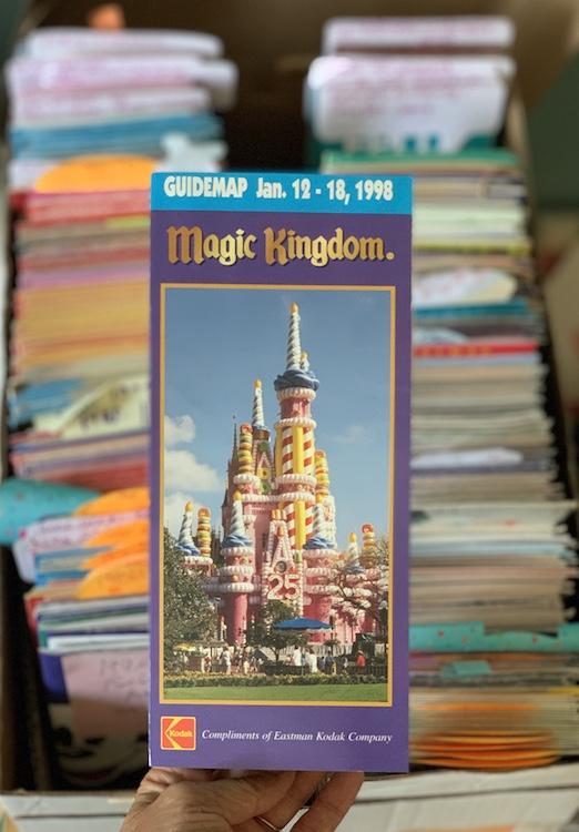 box of Disney maps with 1998 magic kingdom map