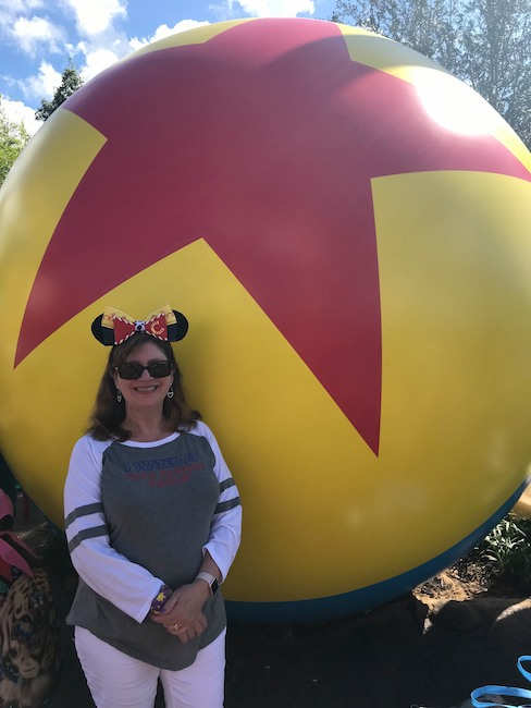 carolyn at toy story land pixar ball know before your disney vacation