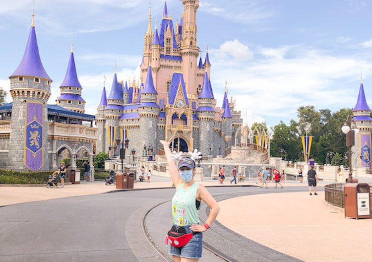 cinderella castle with mask traveling to disney world