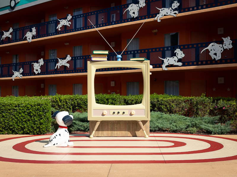 A Dalmatian looks at a TV at Disney's All-Star Movies Resort