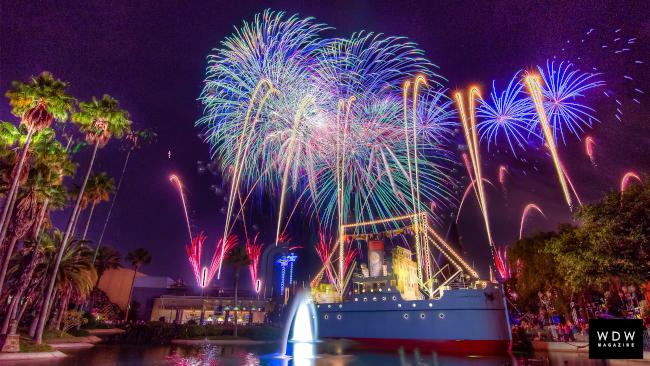 Fireworks burst above Echo Lake on New Years Eve at Disney World