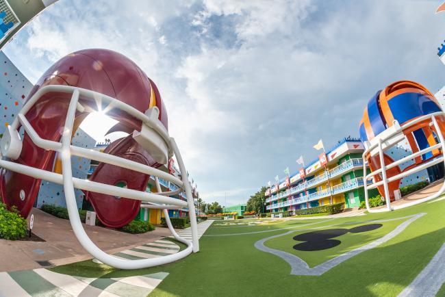 Giant football helmets flank the field at Disney's All-Star Sports Resort