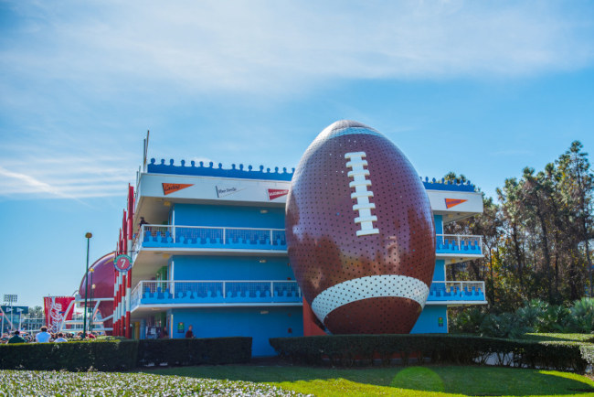 A giant football conceals a staircase right next to the Resort building