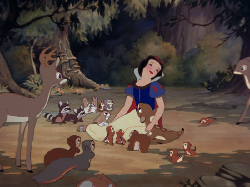 Snow White sings for the creatures of the forest