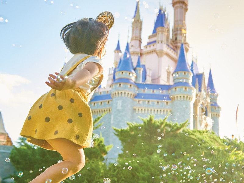 little girl in front of Cinderella Castle