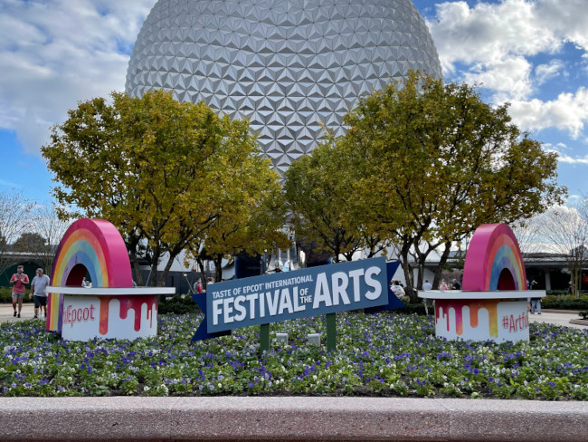 Spaceship Earth with a Festival of the Arts banner in front of it