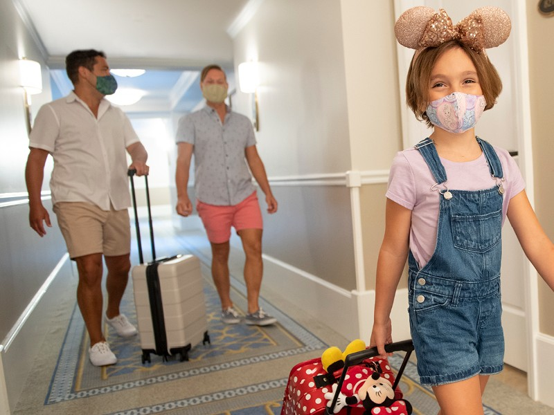 two dads and little girl at Walt Disney World