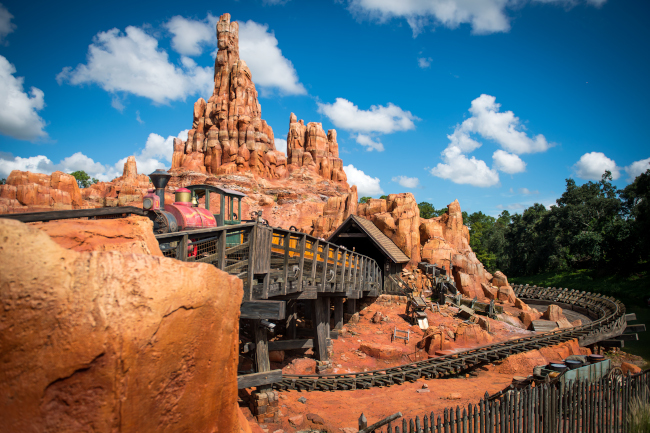 One of the Big Thunder Mountain Railroad trains passes over a bridge _what-does-magic-kingdom-look-like