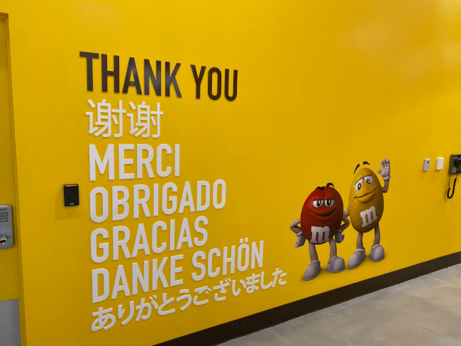 The red and yellow m&ms thank customers in multiple languages at the M&M Store