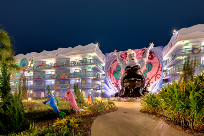 A giant statue of Ursula towers over rooms at Disney's Art of Animation Resort