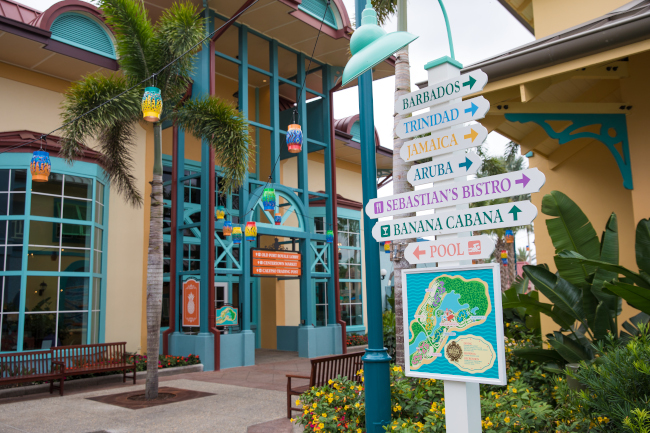 A sign points towards different areas of the Caribbean Beach Resort