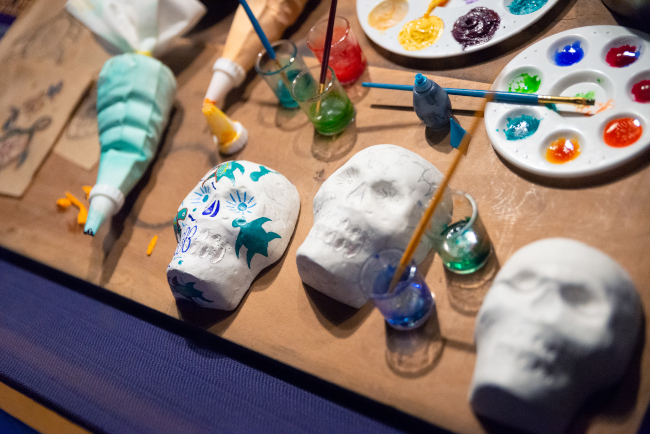 Sugar skulls being hand-painted at the Mexico Pavilion