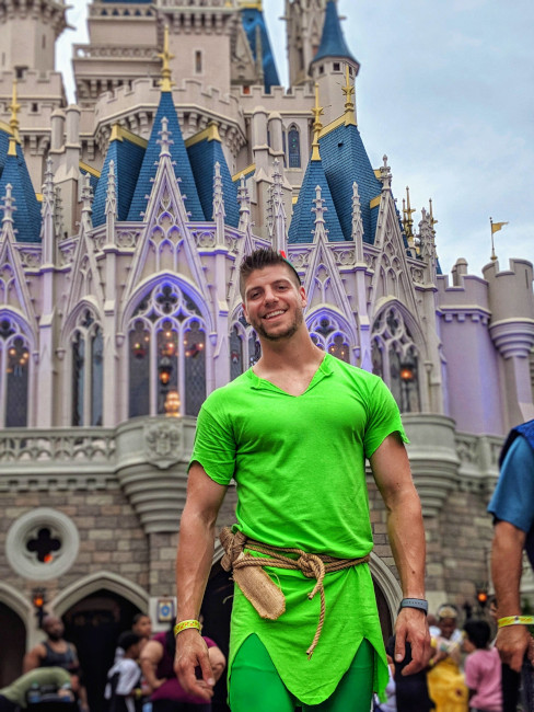 Nate Weir outside of Cinderella's Castle, dressed as Peter Pan