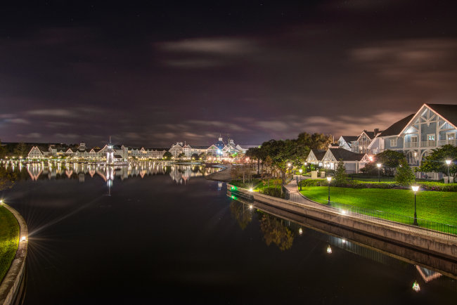 The exterior of Disney's Beach Club Resort at night