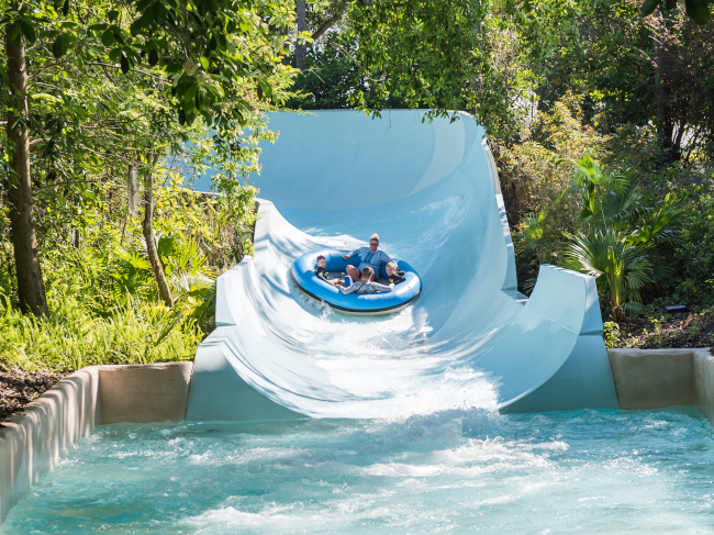 Guests zoom towards the end of Teamboat Springs at Disney's Blizzard Beach