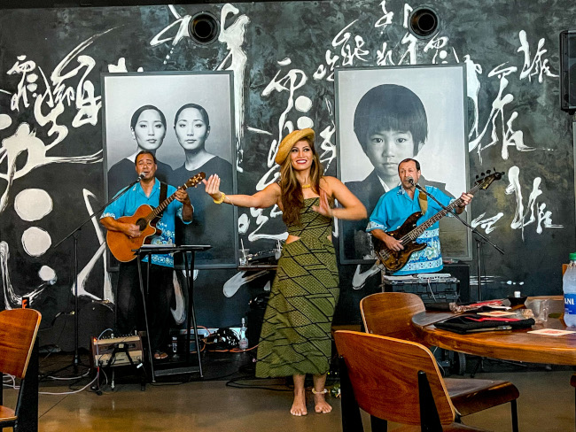Live musicians play for the guests of the Suntory Morimoto Luau