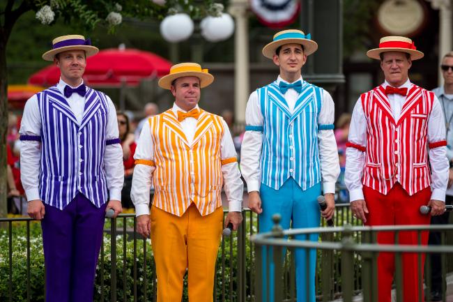 The Dapper Dans in their multicolored attire