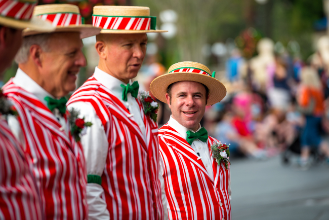 The Dapper Dans sing with a smile, while dressed in their holiday attire