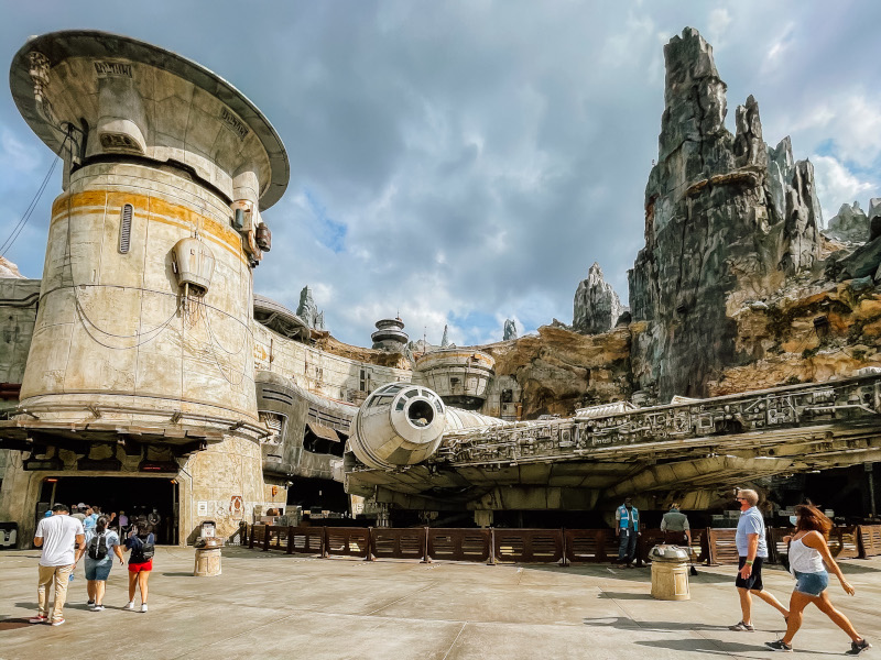 The exterior of the Smuggler's Run ride, and the Millennium Falcon at Disney's Galaxy's Edge