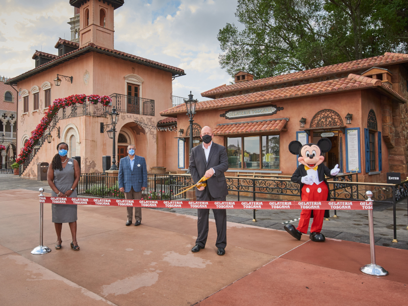 Bob Wilson, Kartika Rodriguez, Mahmud Dhanani, and Mickey Mouse at the grand opening ribbon cutting for Gelataria Toscana