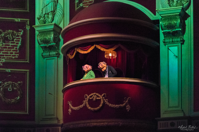 Statler and Waldorf wearing 3D glasses during a showing of Muppet*Vision 3D