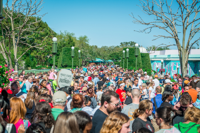 A dense crowd of guests at the Magic Kingdom's Tomorrowland
