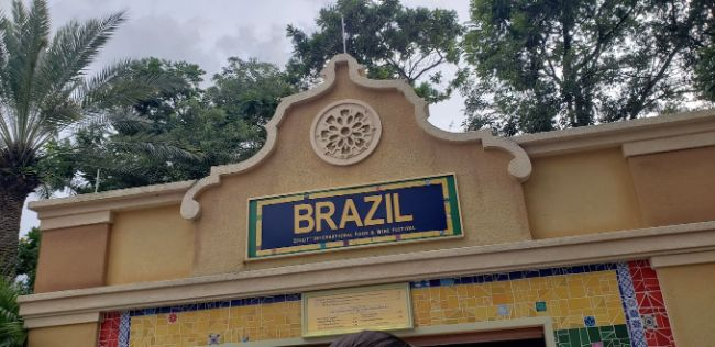 2021-EPCOT-Food-and-Wine-Festival_Brazil-Booth-Sign_Rain-Blanken