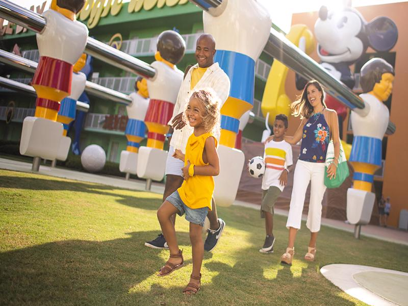 family enjoying disney pop century resort hotel - Disney hotel Florida discounts