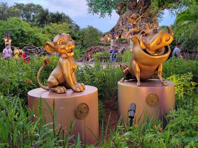 Animal Kingdom Golden Statues Simba Pumbaa Gold Statue Disney World 50th Anniversary_Lazar