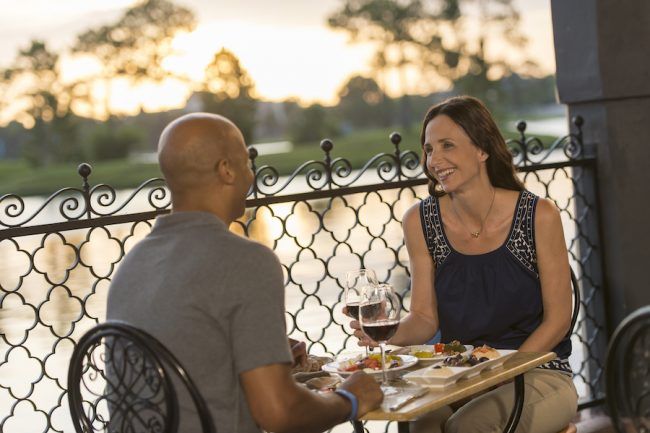 couple-enjoying-dinnner-and-wine-at-spice-table-epcot-appetizing-occasions_disney-parks-blog