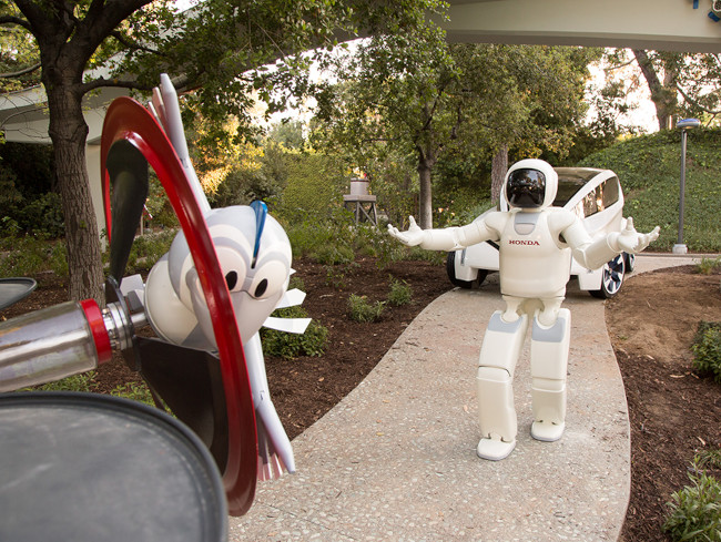 Honda's Asimo and Bird, part of the newest incarnation of Autopia at Disneyland