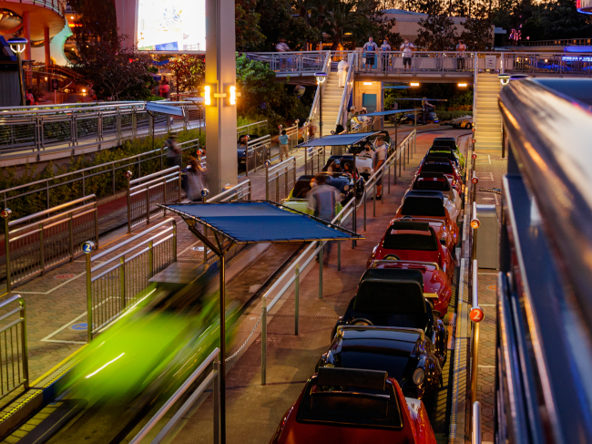 Guests load into cars at Autopia at Disneyland