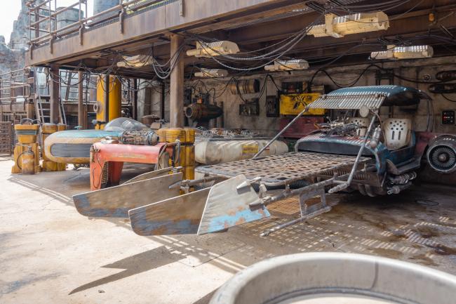 A speeder sitting in a garage at Galaxy's Edge