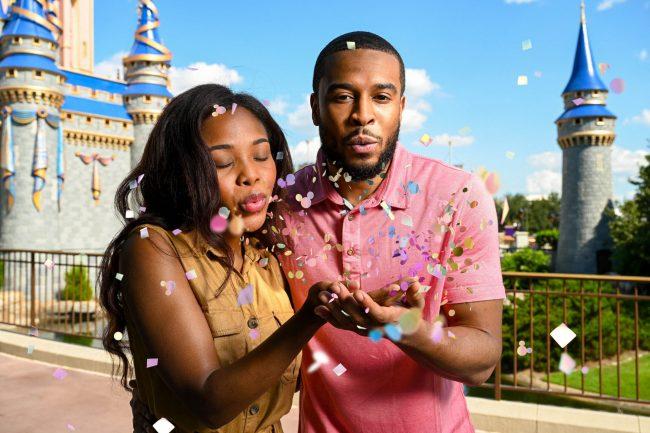couple-using-confetti-magic-shot-cinderella-castle-wdw-50th-anniversary_disney