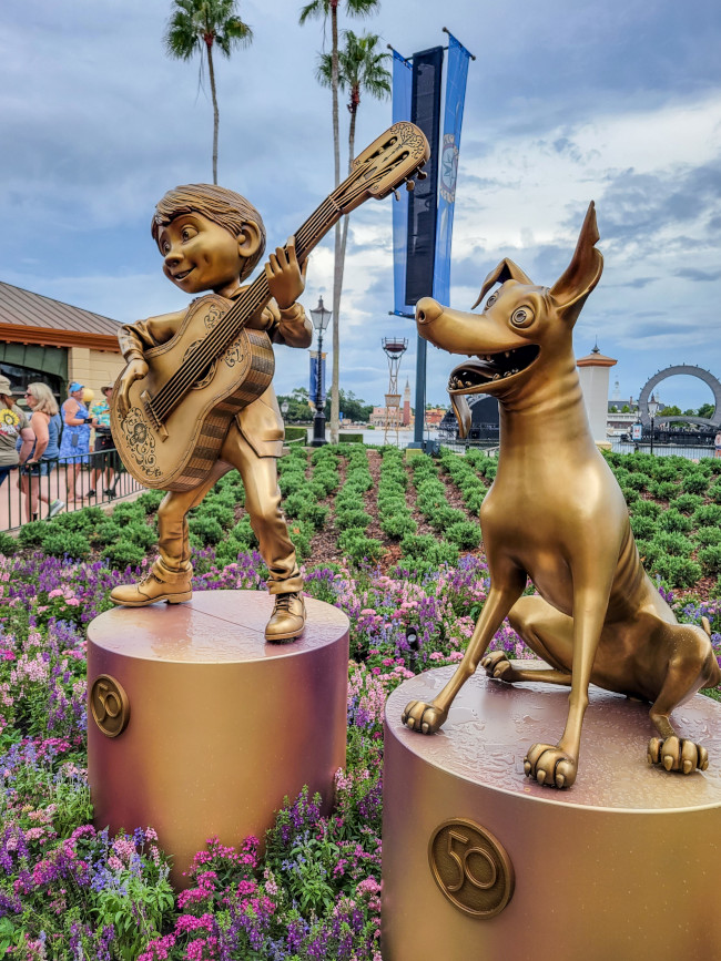 dante-and-miguel_where-to-find-disney-fab-50-statues-in-epcot_lazar